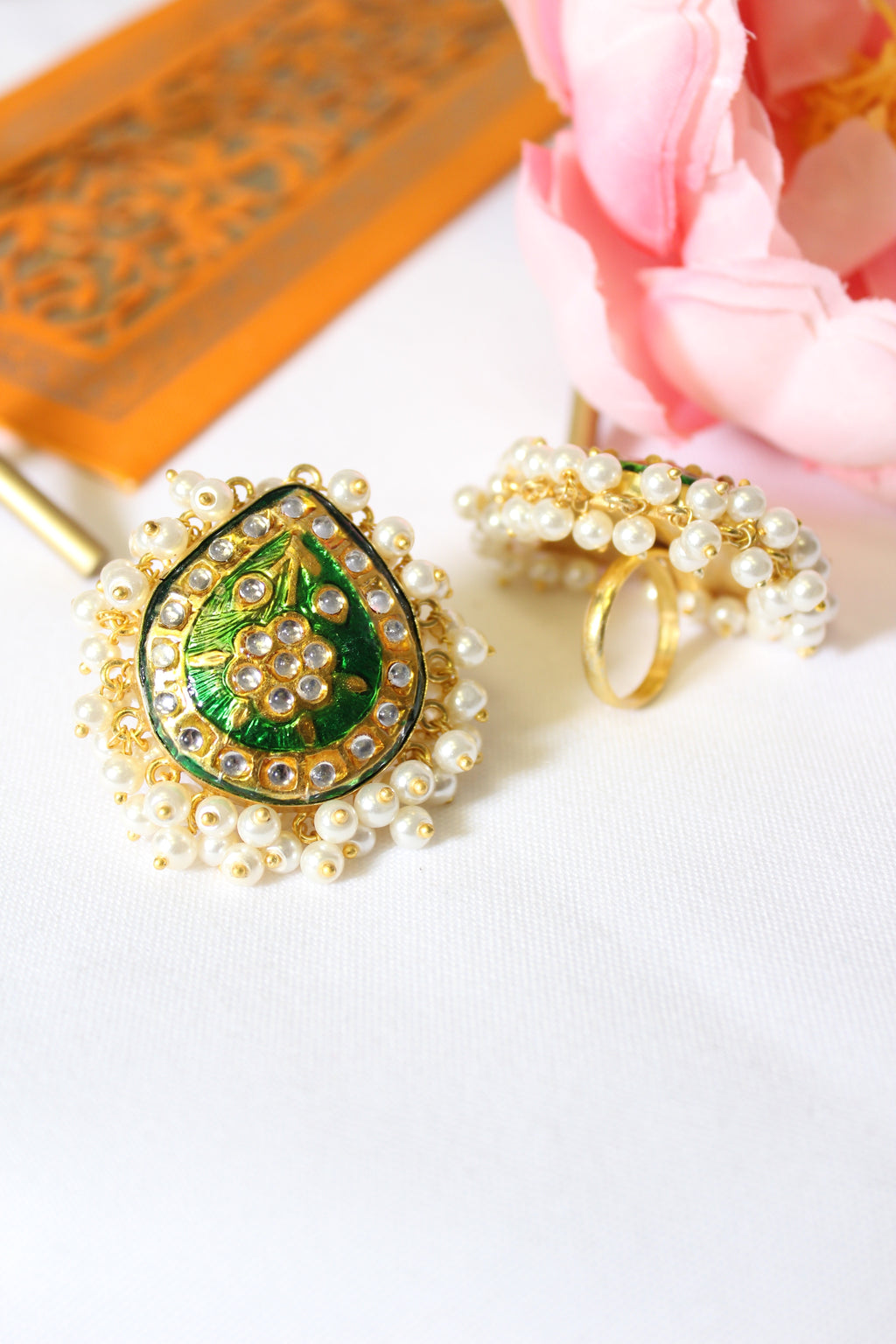 Emerald green kundan meenakari ring lined with pearls