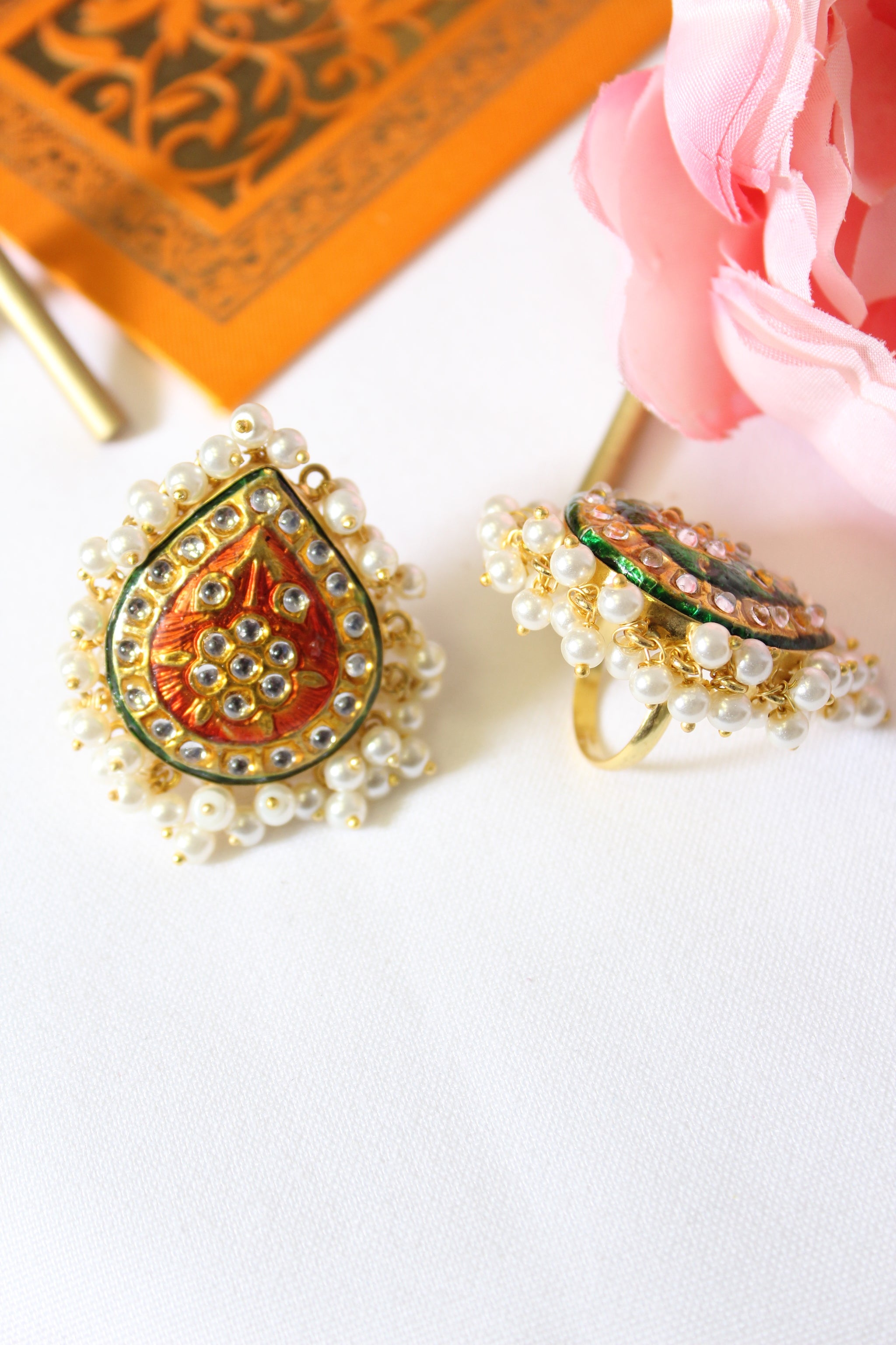 Red kundan meenakari ring lined with pearls