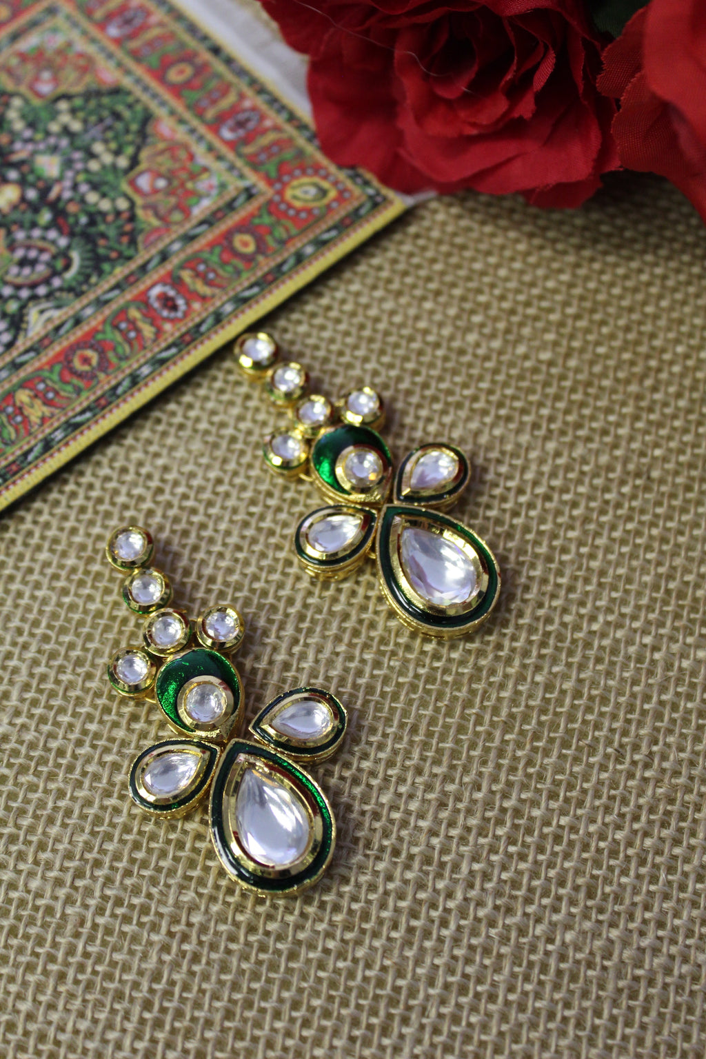 Kundan drop studs with traditional emerald green meenakari