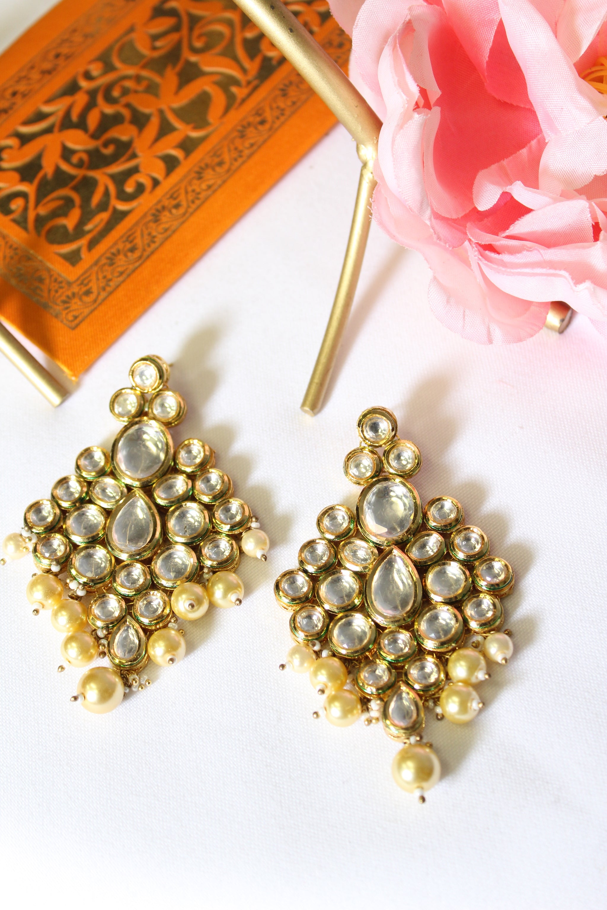 Diamond motif kundan earrings with champagne gold pearls