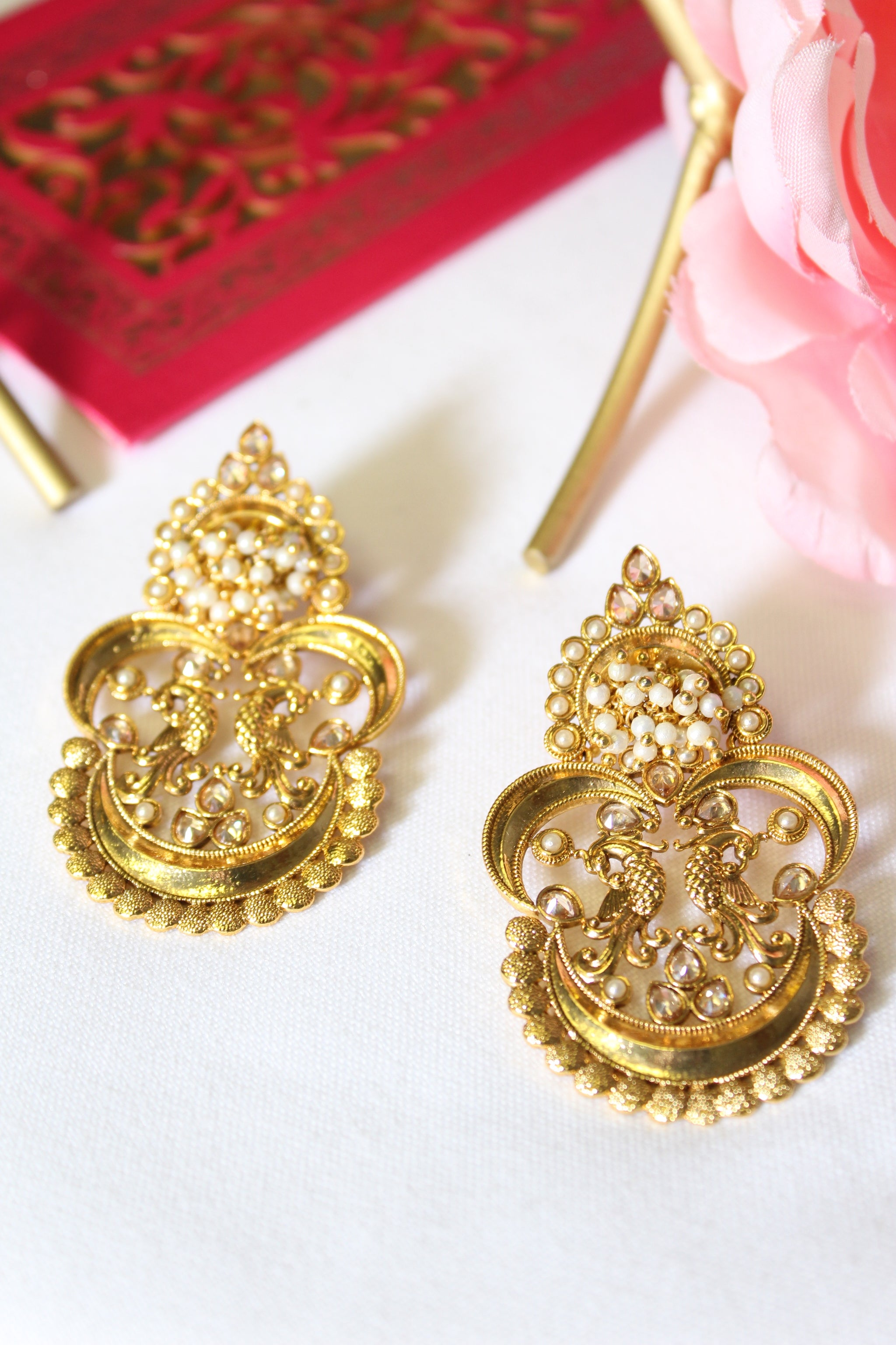 Peacock motif gold plated earrings studded with pearls