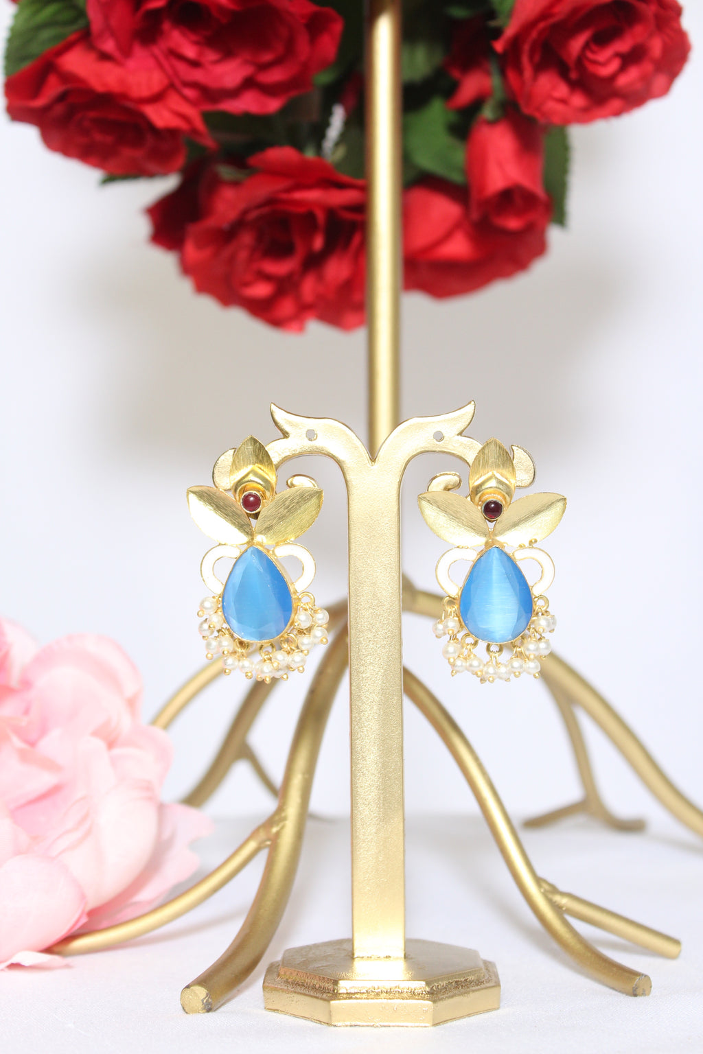 Sky blue drop stone with abstract gold patti stud