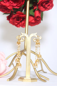 Uneven dangling gold jhumki studs with pearls