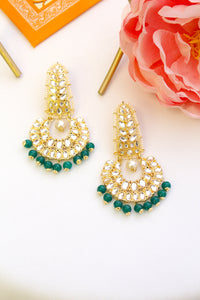 Gold plated long kundan chandbali with emerald green beads