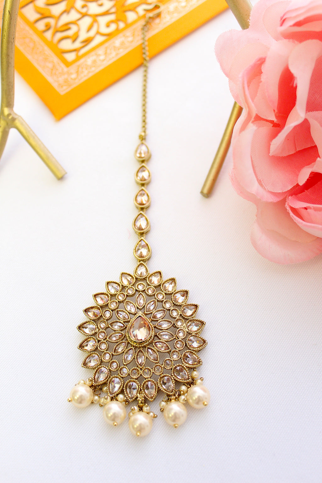 Champagne gold kundan drop shape tika with pearls