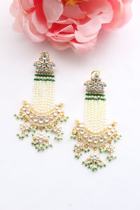 Long chandelier earrings with pearl and green bead detailing