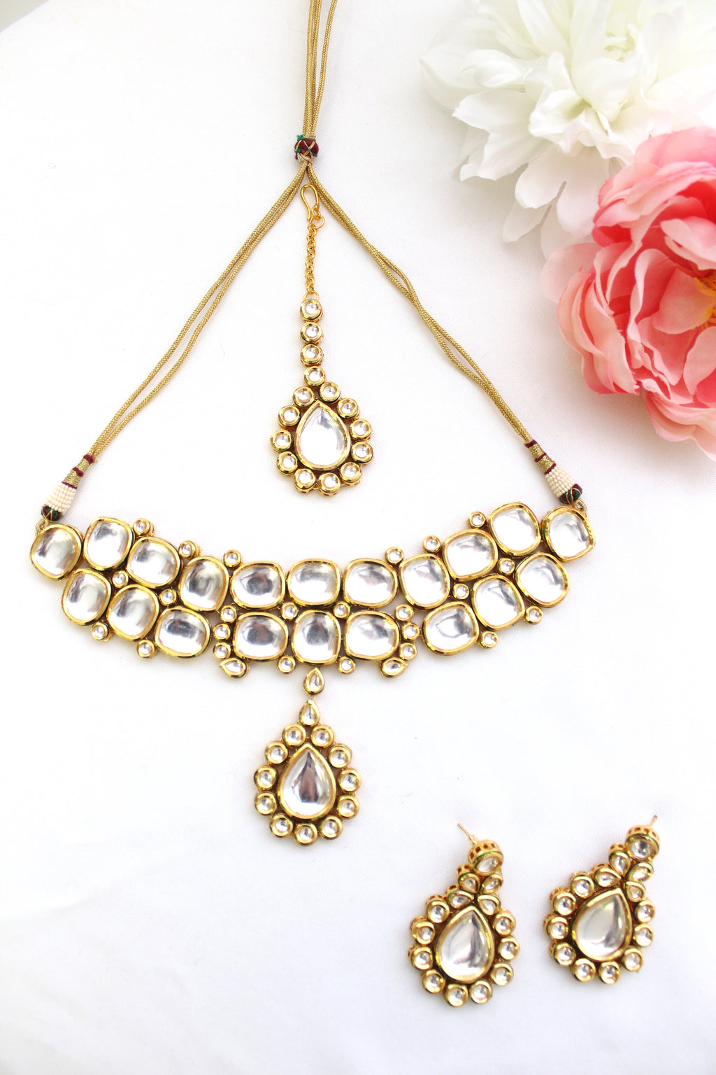 Gold plated uncut kundan choker necklace set with tikka