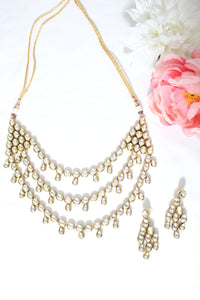 Gold plated kundan necklace set with three layers