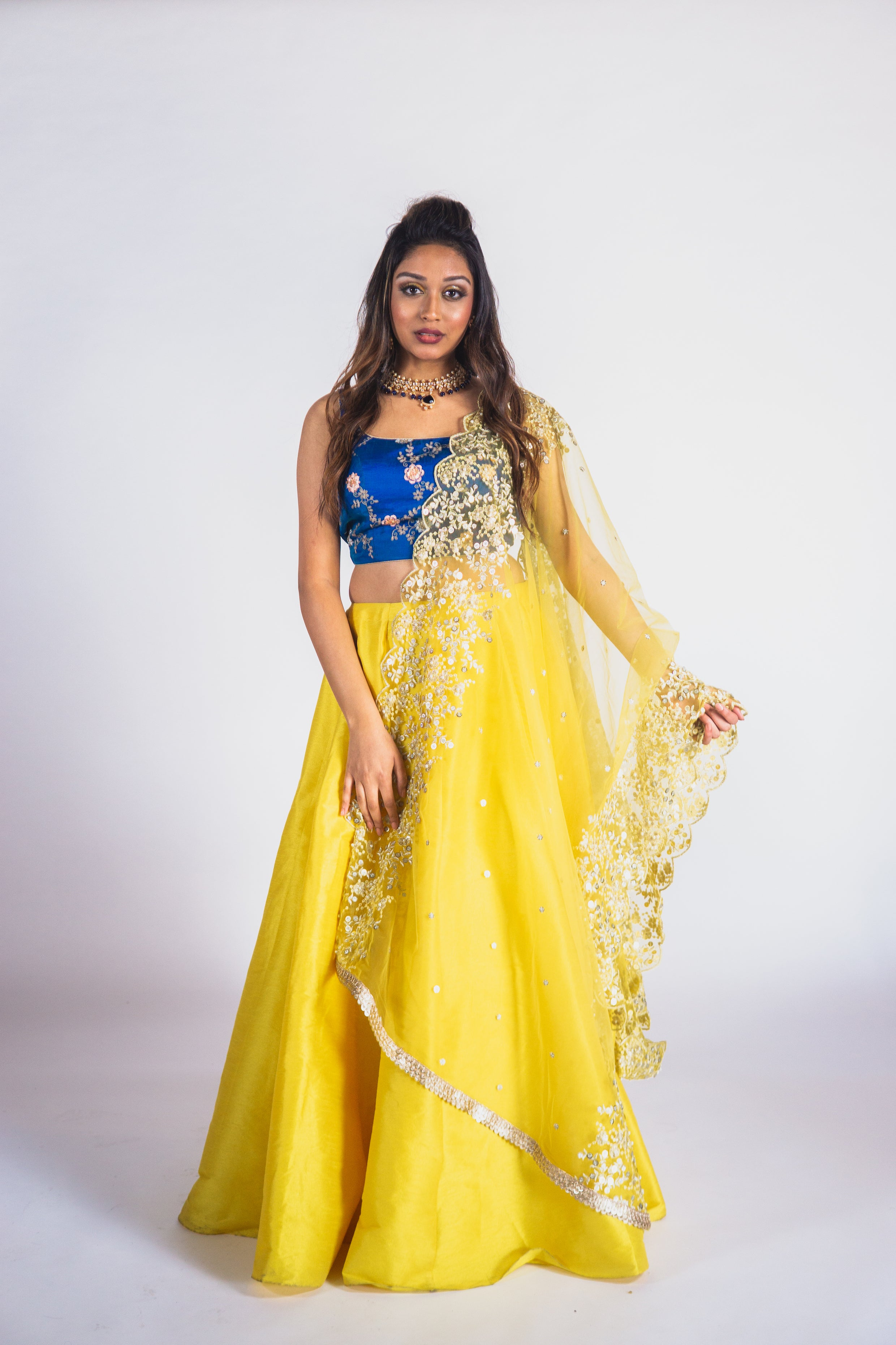 Electric blue resham and aari work blouse with a solid lemon yellow cotton silk lehenga & sheer 2 side scallop edge dupatta with dori & sequin work.