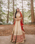 Indian Bridal Wedding Lehenga in Champagne Gold Sequins Fabric And Gold Zardosi Hand Embroidery Red Border - Sushma Patel