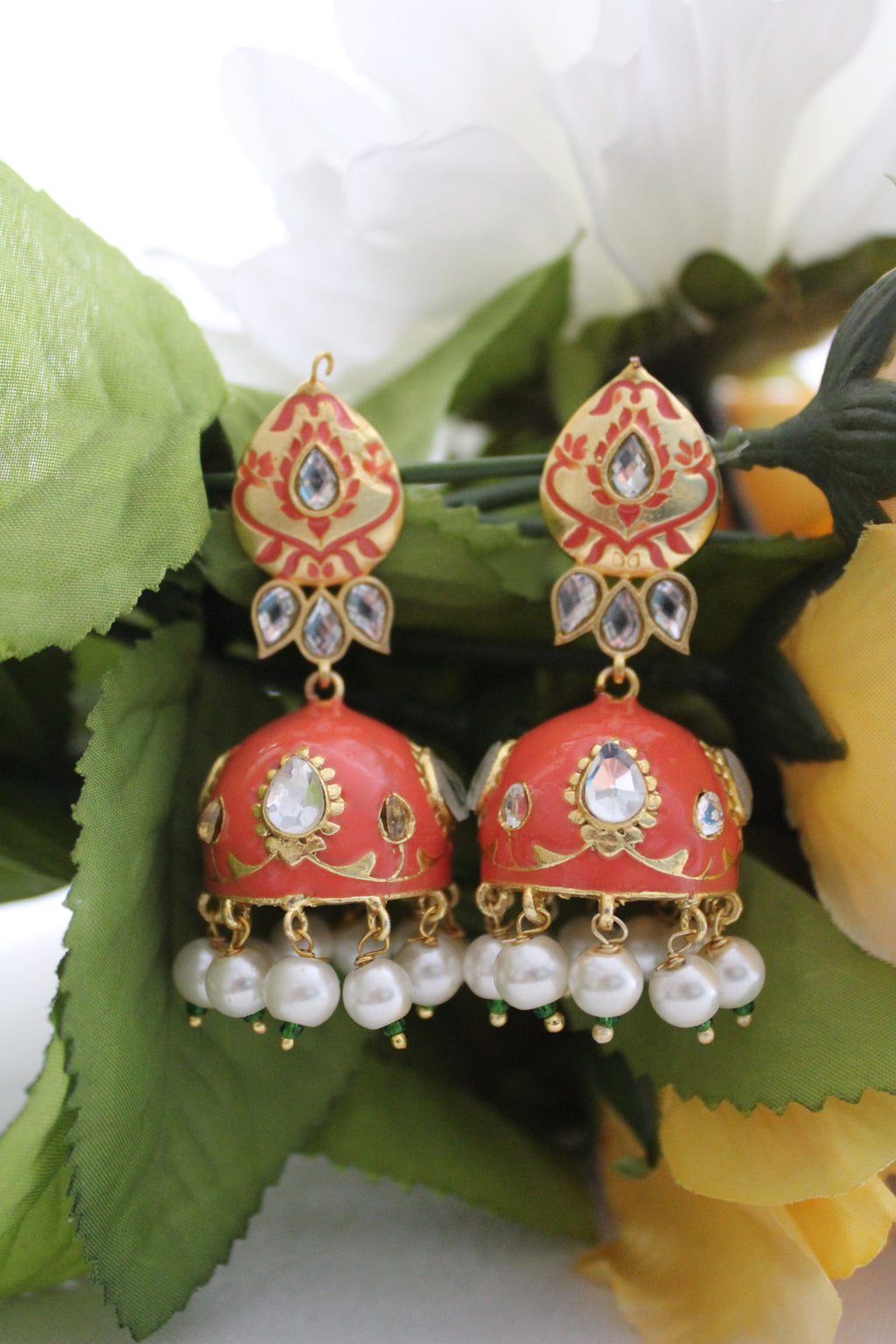 Orange meenakari jhumki with pearls and kundan