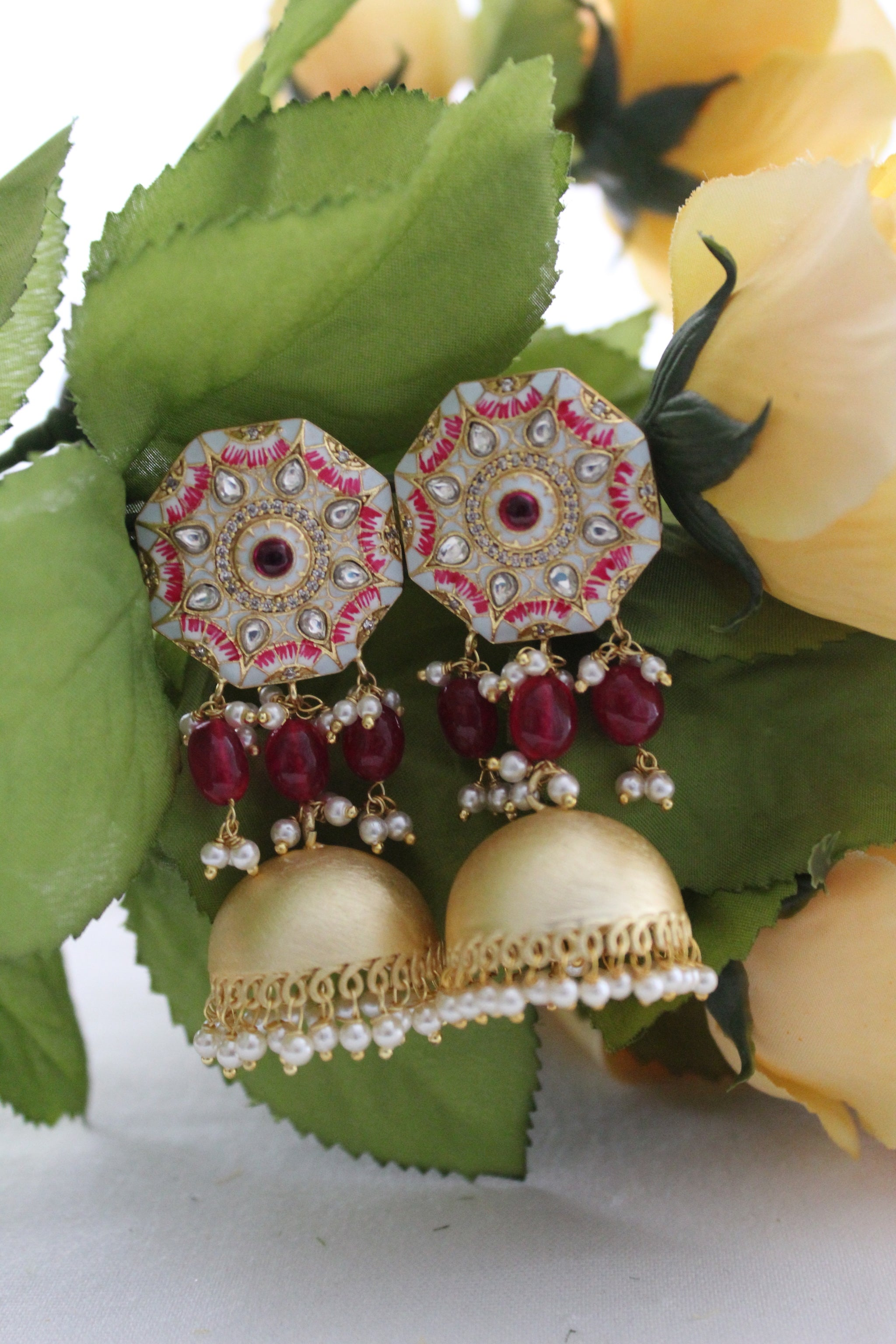 Gold jhumki & maroon beads with white floral meenakari and kundan