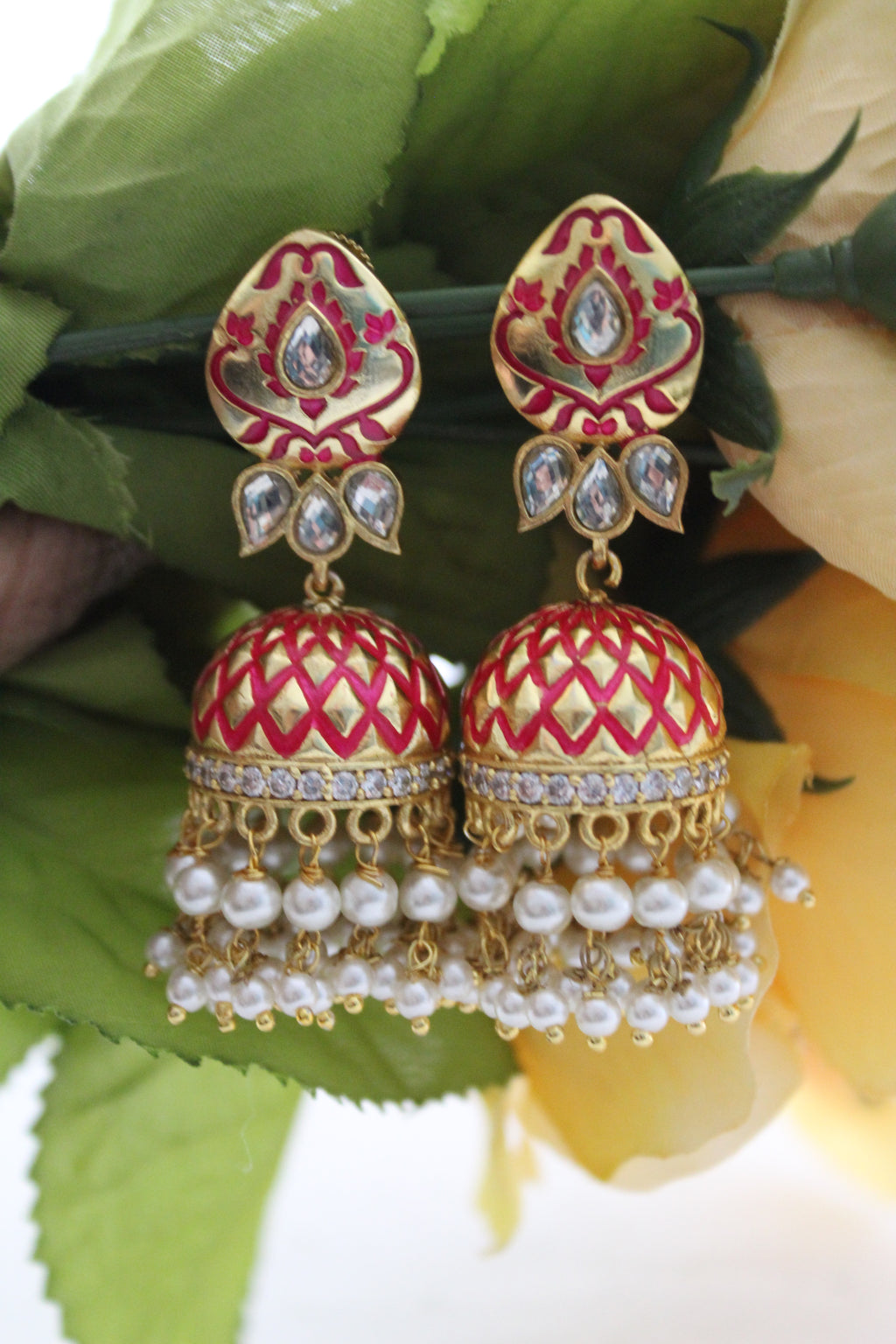 Gold & red meenakari jhumki with dangling pearl beads and kundan.