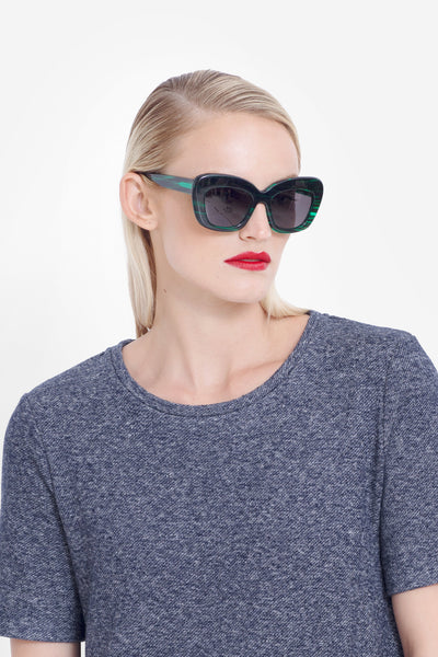 Kittan Exaggerated Cat-Eye Sunglasses Model Side Angled Detail | Emerald
