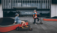 Man and Woman enjoying the Xiaomi Pro electric scooter