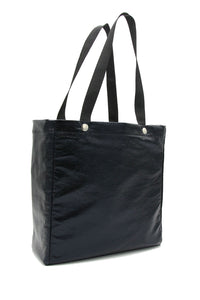 Clear stadium bag with black faux leather sleeve