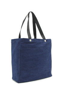Clear stadium bag with blue denim sleeve
