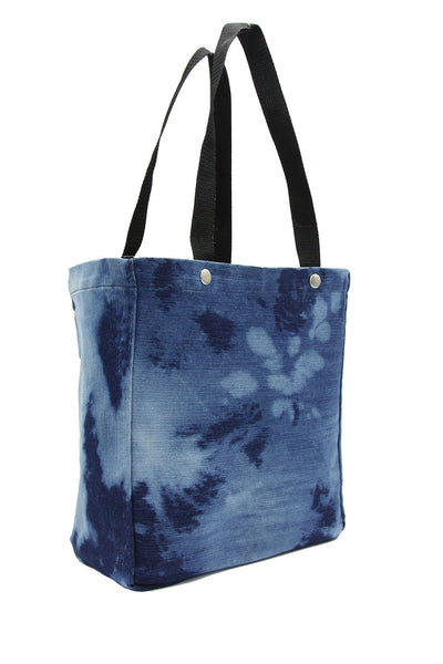 Clear stadium bag with acid wash denim sleeve
