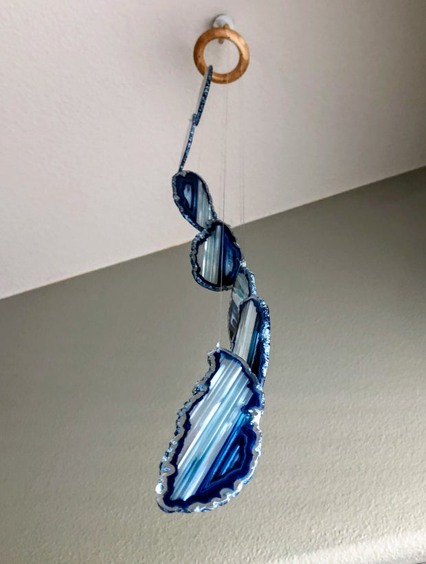 "Wind chime w/ 7 Medium Agate slices up to 5"" long each"