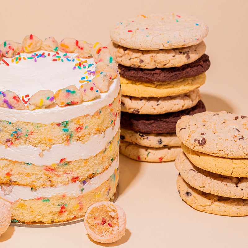 Close-up of Birthday Cake 6-inch, Dozen Assorted Cookies stacked and Strawberry Shortcake Truffle bite