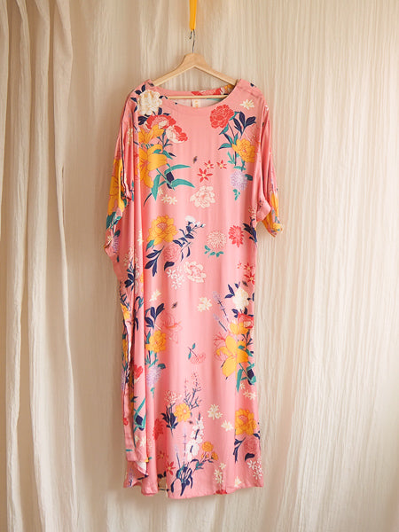 limonata adaptive dolce dress in pink fiorella floral print hanging on a hanger