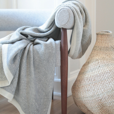 Handmade 100% baby alpaca Kimsa throw blanket in Jessie Black's home.