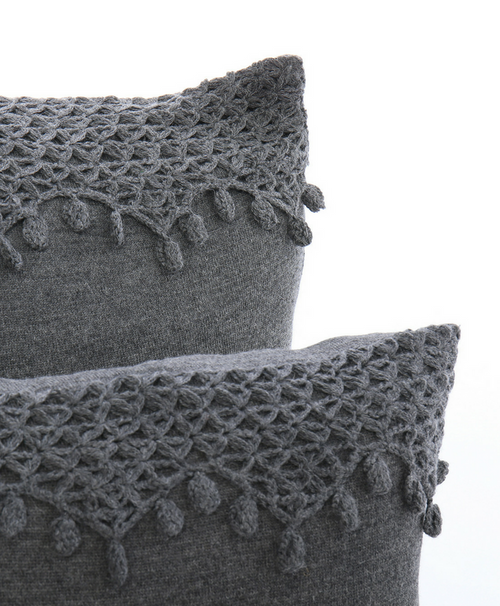 Uvas hand-crocheted pillow by Sefte Living in Charcoal. The hand-crocheted detail is inspired by the Pisco grapes of Peru.