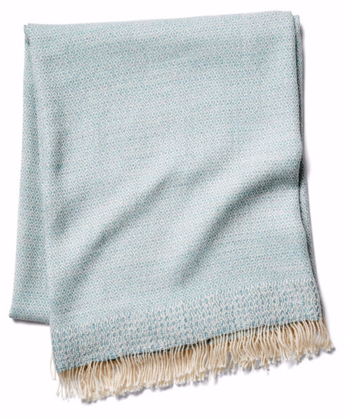 Chuspi Woven throw in seaglass by Sefte Living. Our organic alpaca and wool blend throw is woven by artisans in Peru.