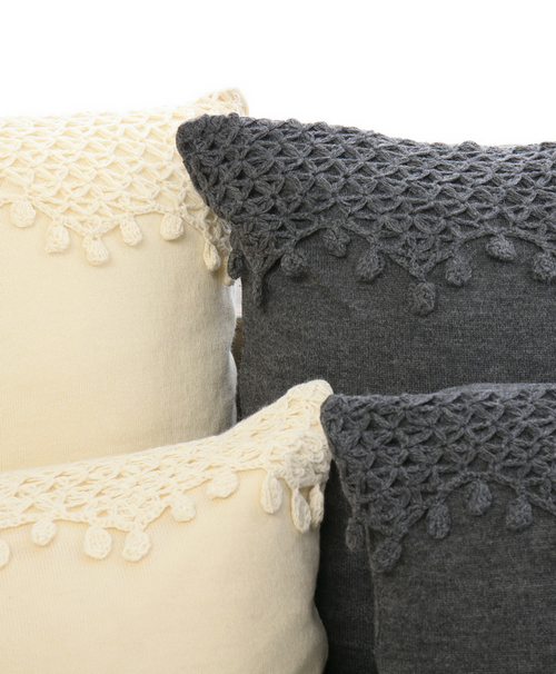 Meet our Uvas alpaca throw pillow. The hand-crocheted detail is inspired by the Pisco grapes of Peru.