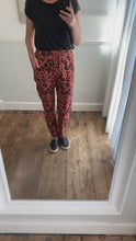Load and play video in Gallery viewer, Salmon pink animal print stretch trousers