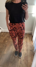 Load image into Gallery viewer, Salmon pink animal print stretch trousers
