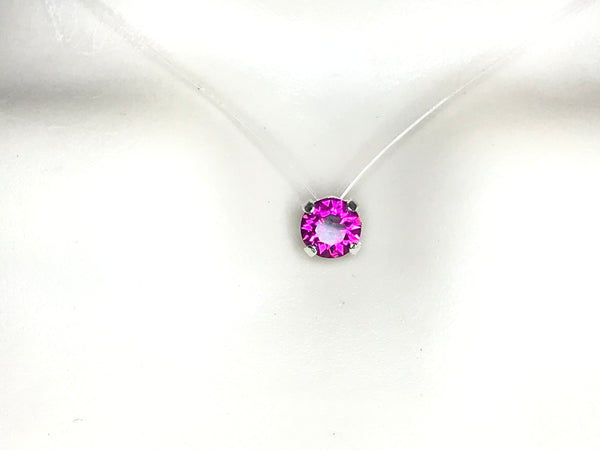 Collier ras du cou solitaire strass de Swarovski de 6 mm rose fuchsia fil nylon transparent