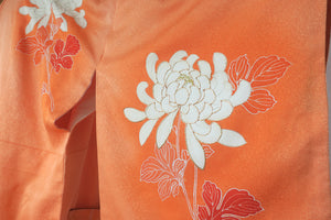 Orange Kimono's sleeve drop