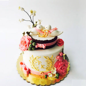 Floral With Rings Decorated Cake - Eggless