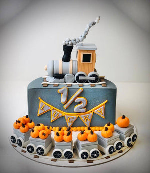 Lucky Train Theme Half Birthday Cake - Eggless