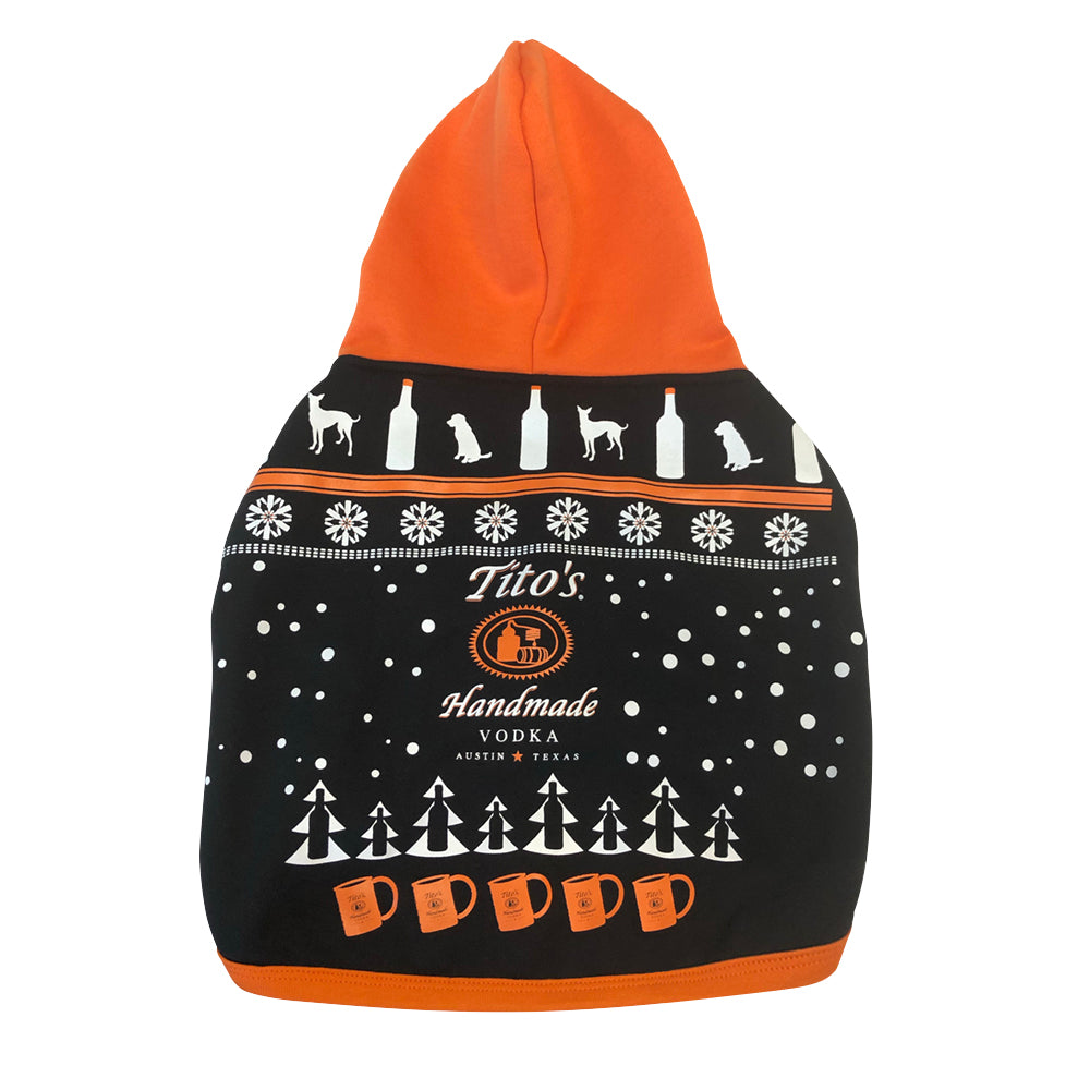 Back view of black, orange and white hooded dog sweatshirt with Tito's Handmade Vodka logo and holiday-inspired designs of dogs, trees, snowflakes, bottles, and copper mule mugs