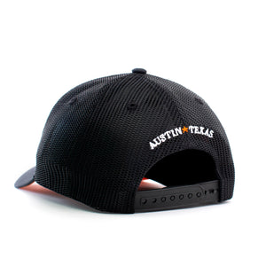 back view of black trucker hat with Austin Texas