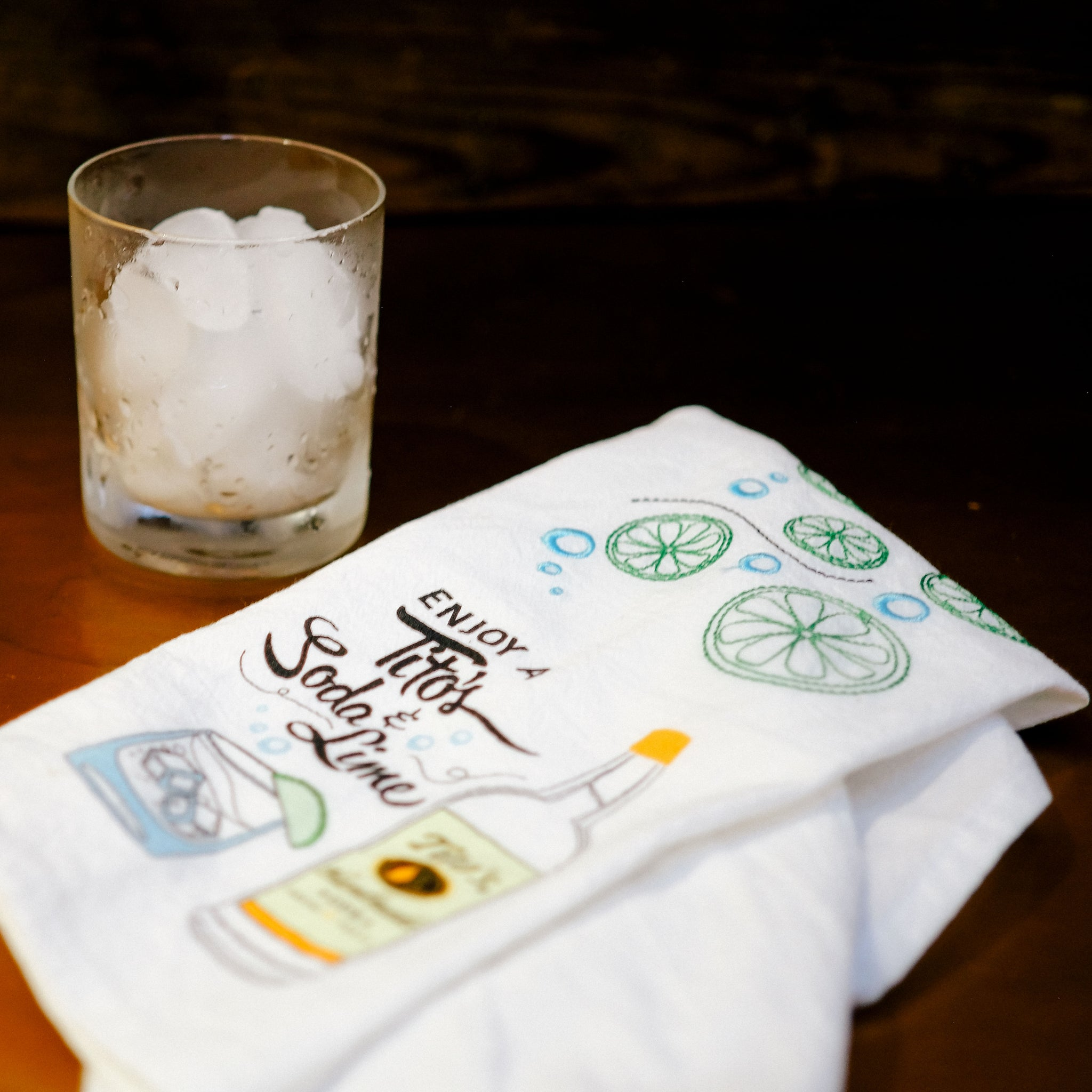 Tea towel and cocktail sitting on a brown table