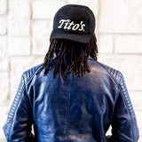 Man wearing Tito's Old School Cap