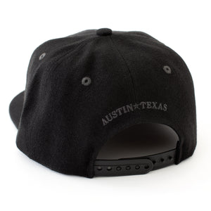 Black flat bill snapback with Austin Texas on the back
