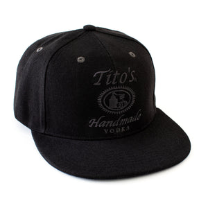 Tito's Handmade Vodka logo embroidered in black on front of black flat bill hat