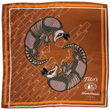 Copper silk scarf featuring white Tito's Handmade Vodka logo with illustrated armadillos and bottle designss
