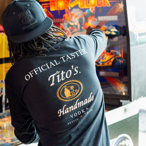 Man wearing black long-sleeved t-shirt with Official Tito's Taster mark