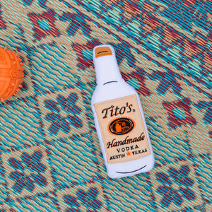 Squeaky, floatable dog toy. Front looks like a Tito's bottle, back has Vodka for Dog People and PrideBites graphics