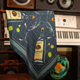 Navy silk scarf with illustrated Tito's Handmade Vodka bottle, martini glass, and green olives