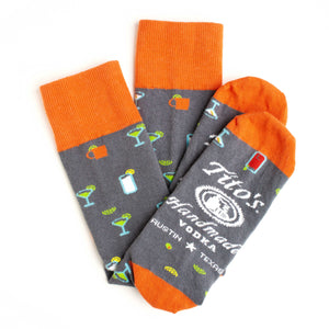 Gray and orange half-calf socks with Tito's Vodka logo and various cocktails printed on