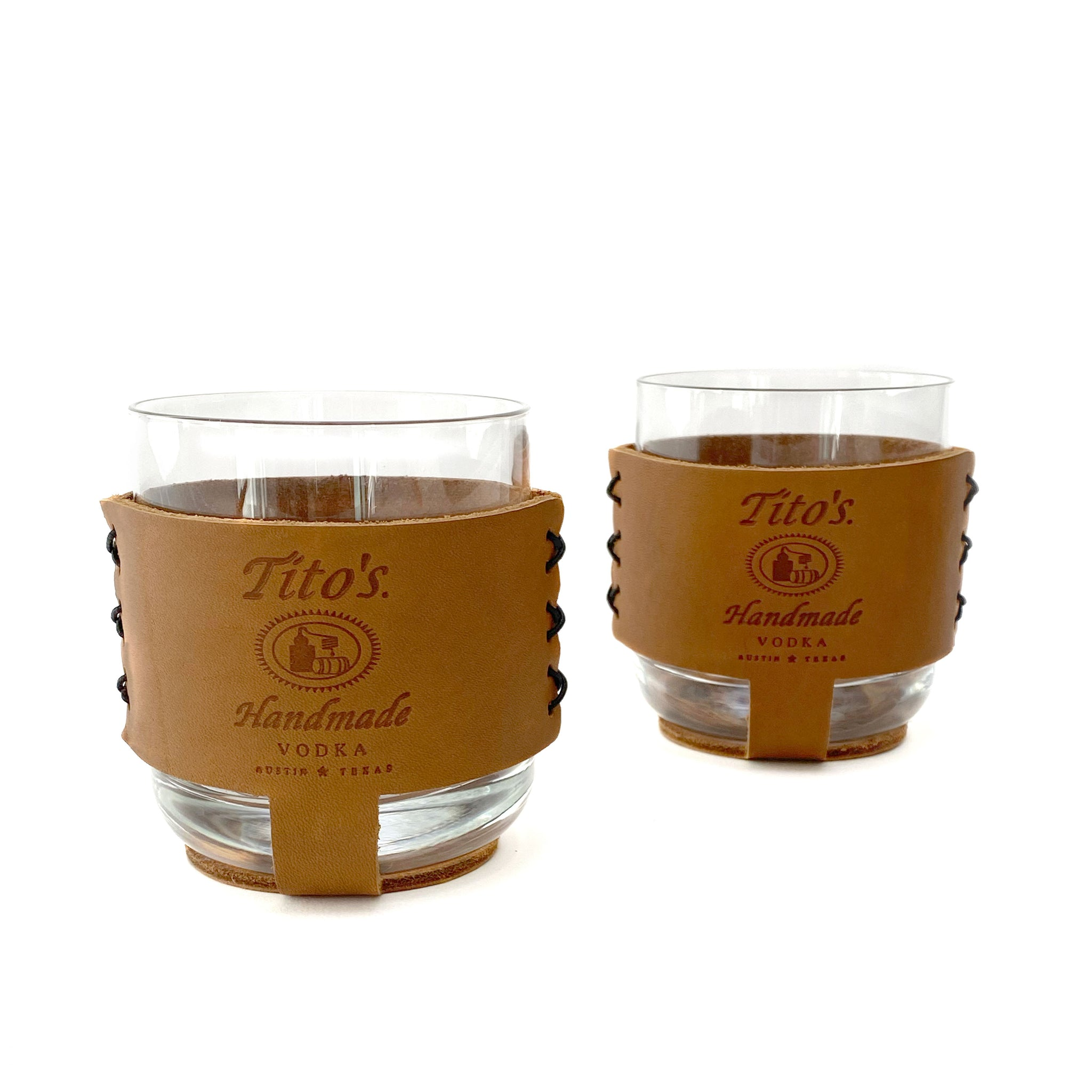 Packaged set of rocks cocktail glasses in leather sleeves branded with Tito's Handmade Vodka logo