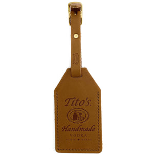 Front view of leather luggage tags with Tito's Handmade Vodka logo