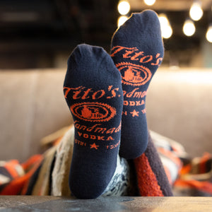 Black/sand colored half-calf socks with Tito's Handmade Vodka logo on bottom
