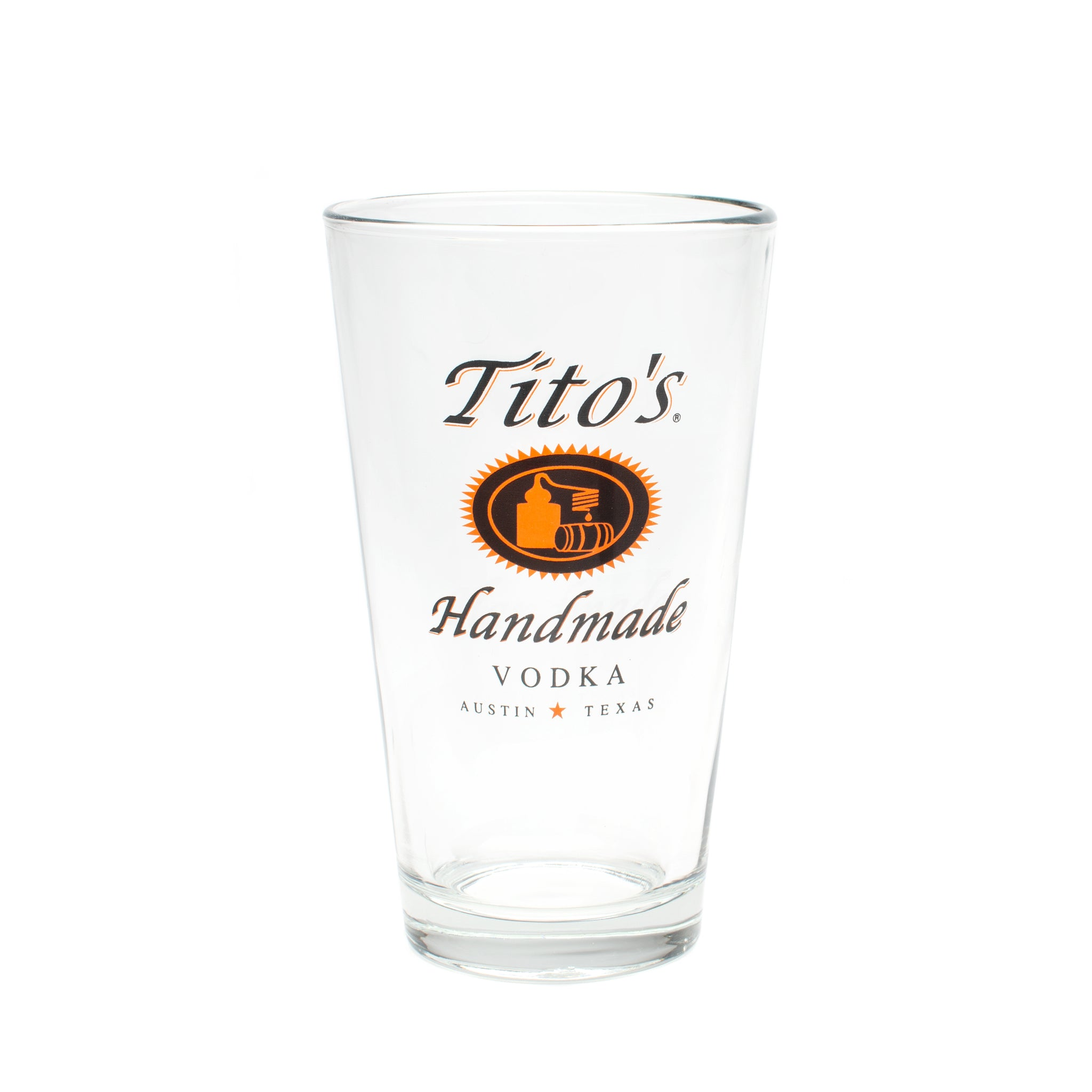 Pint glass with tito's handmade vodka logo on one side